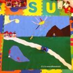 tappeto gioco in panno lenci per bambini con montagne lago e casette
