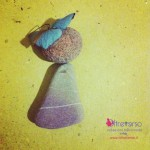 bambolina_sassi_sculture_mare_oltreverso_stone